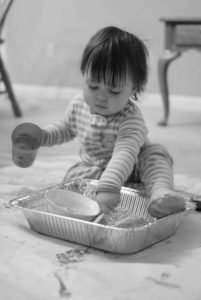 Busy Toddler Playing with Rice